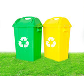 Green and yellow plastic trash recycling container with recycle