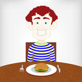 Hungry smiling boy sitting at the table to eat a burger