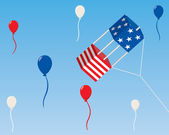 A box kite decorated with the stars and stripes flies in the sky In the background are red white and blue balloons