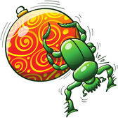 Green dung beetle making its best effort to push and roll a beautifully decorated Christmas ball with its middle and hind legs