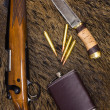 Постер, плакат: Rifle cartridges knife and flask