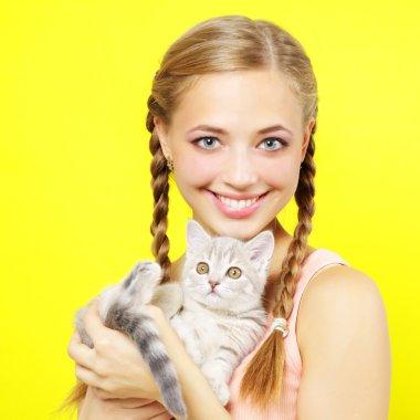 Smiling girl with Scottish kitten