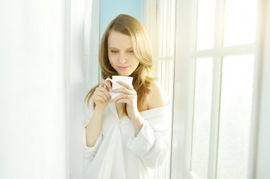 Morning Coffee. Attractive girl with cup of coffee stock vector