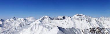 Panorama of snowy mountains. Caucasus Mountains, Georgia, view from ski resort Gudauri. stock vector