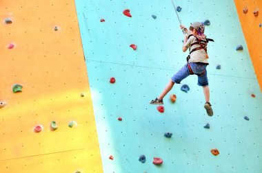 Child climbing up the wall