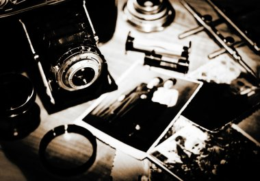 Vintage still life with retro photo camera and old photos