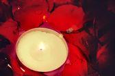 Fotografie brennende Kerze und rose