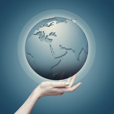 Earth globe into female hand