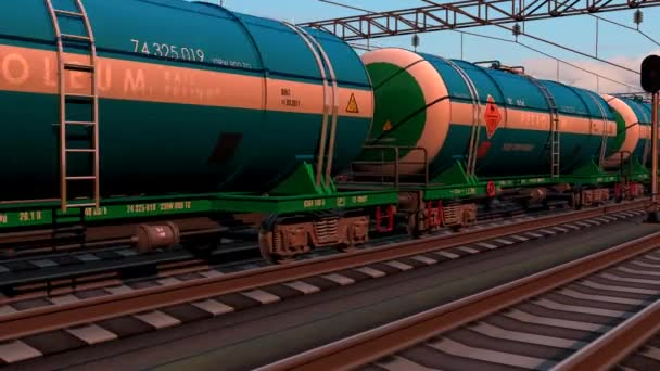 Freight train with petroleum tank cars passing by the railway station on sunset