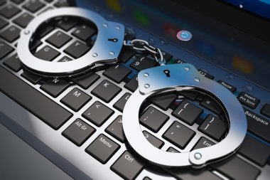 Creative abstract cyber crime, online piracy and internet web hacking concept: macro view of metal handcuffs on laptop notebook computer keyboard with selective focus effect stock vector