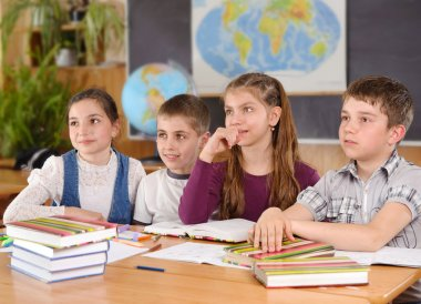 Four pupils in classroom