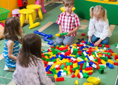 Group of kids playing with colorful constructor