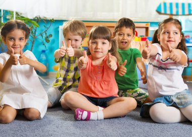 Five little children with thumbs up