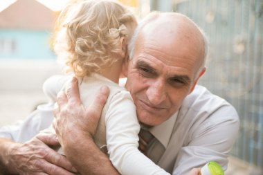 Happy grandfather with granddaughter