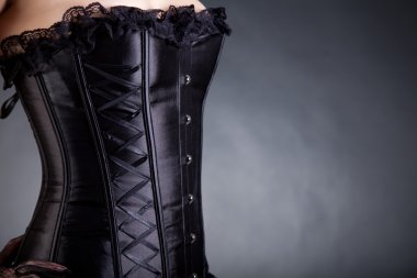 Close-up shot of a woman in black corset