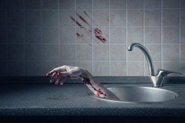 Bloody hand in kitchen sink