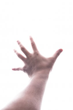 Male hand reaching out the light