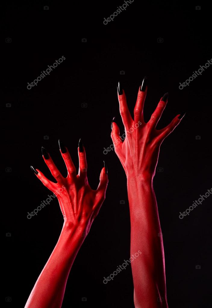 Spooky red demonic hands with black nails, real body-art