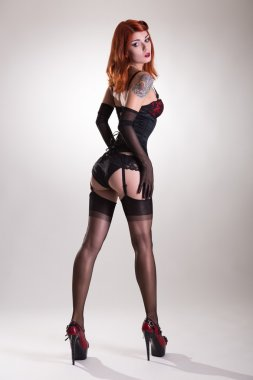 Beautiful redhead pin-up style young woman