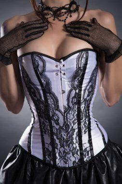 Busty woman in elegant white corset