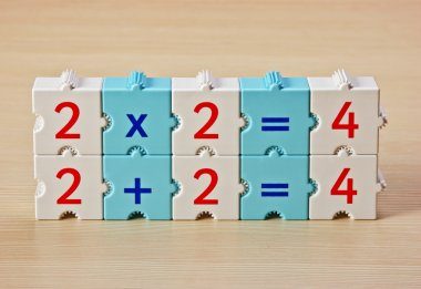 Educational blocks with math problems on the table