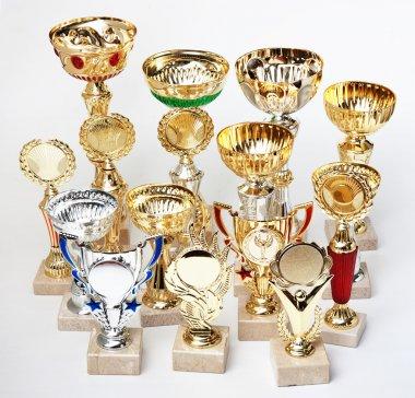 many sports awards on a white background