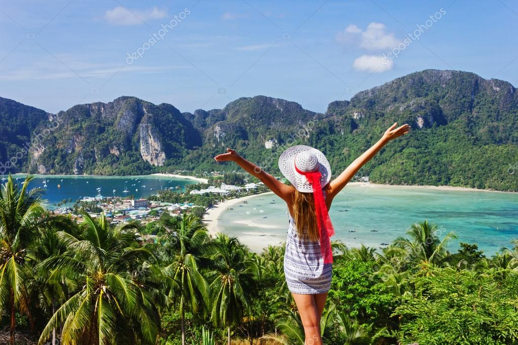 Girl at the resort in a dress on the background of the bays of t
