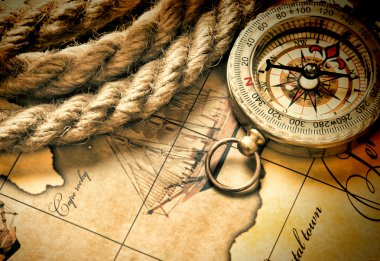 compass and rope on map