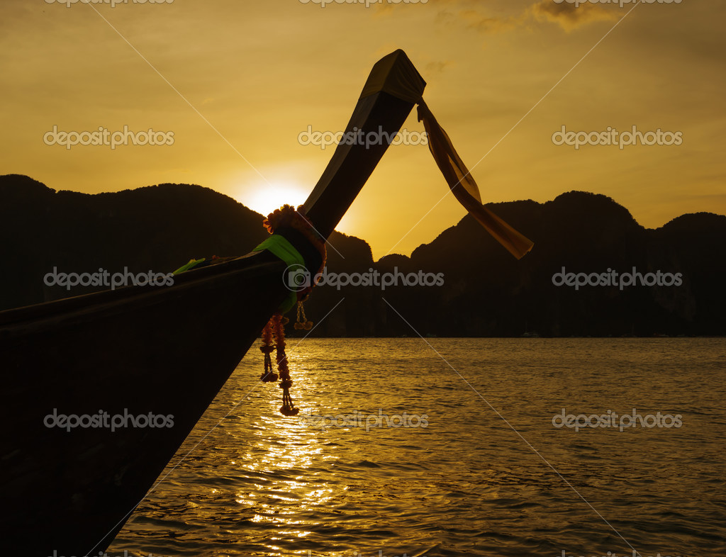 Traditional longtail boat at sunset in Phi-phi Leh island, Thai