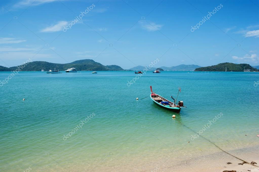 lonely boat on beach of tropical island