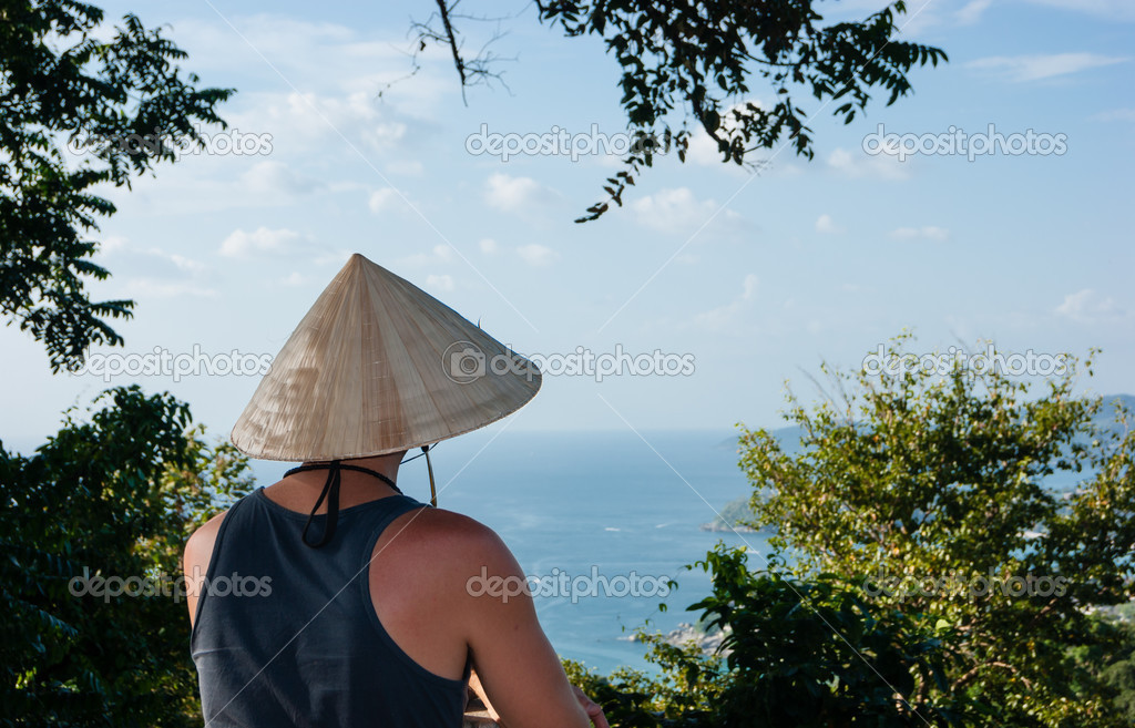 Thai man in the national hat looks at the sea