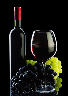 bottle of wine and grapes isolated