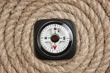 compass on old twisted rope