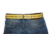 džíny s metr pás zeštíhlující izolovaných na bílém pozadí