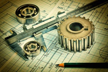 Old technical drawing and pinion with bearings
