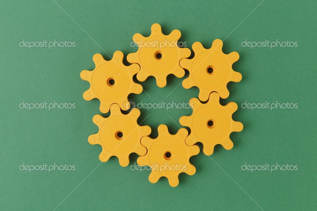 yellow plastic gears — Stock Photo © Observer #41004701
