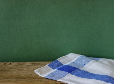 Table-napkin and old wooden deck table