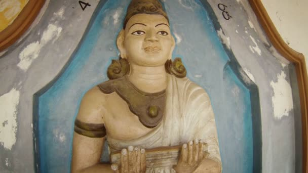 BENTOTA, SRI LANKA - APR 27: Male statue with sacred texts in Big Buddha temple (Kande Viharaya Temple) on Apr 27, 2013 in Bentota, Sri Lanka.