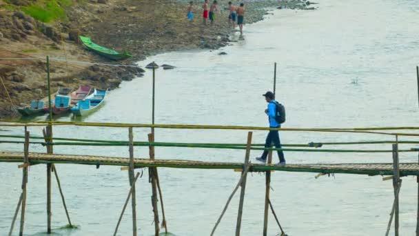 LUANG PRABANG, LAOS - CIRCA DEC 2013: Bamboo bridge over a small river. Convenient way for tourists