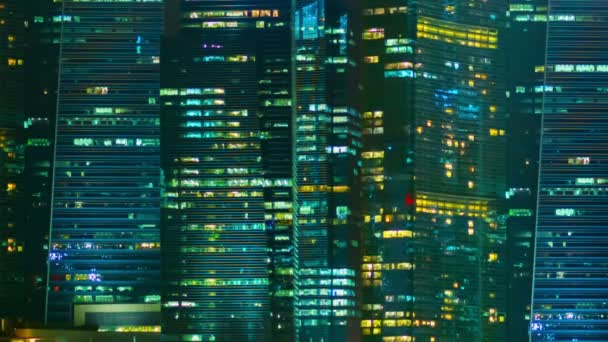 Video 1080p - Night windows of office buildings in a big city. Singapore