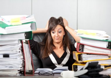 Stress on work.woman holding her head