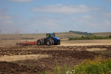 the tractor plowing a field