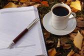 Autumn scene. Coffee cup and books