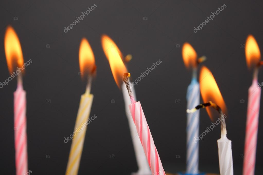 some lit birthday candles close up stock photo puhfoto 24426057