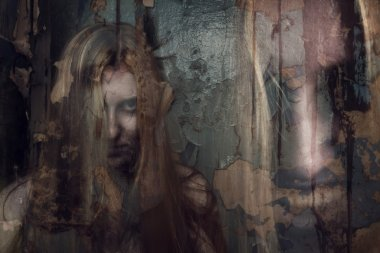 Double exposure of ghost girl in abandoned building
