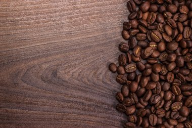 Coffee beans on brown wooden background