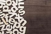 Fotografie Velká a malá písmena dřevěné písmena pozadí