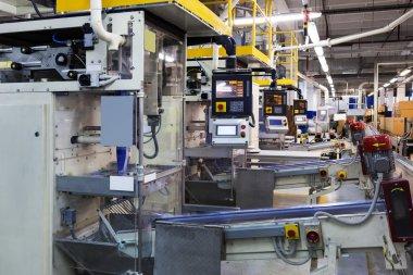 Powerful new conveyor in modern plant stock vector
