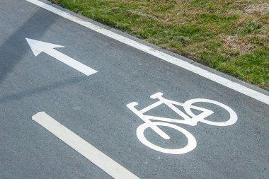Bike lane sign on asphalt