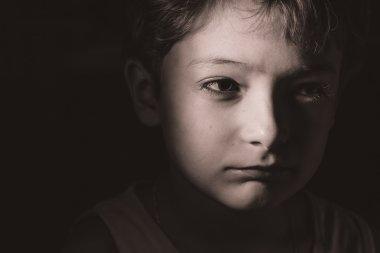 Sad boy in the dark, headshot